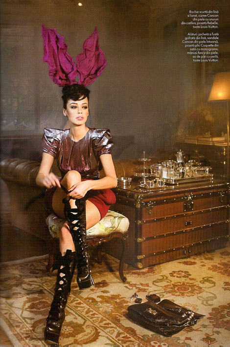 Boot Fashion: Andreea Raicu laces up her Louis Vuitton boots. Elle Romania, 12/2009.