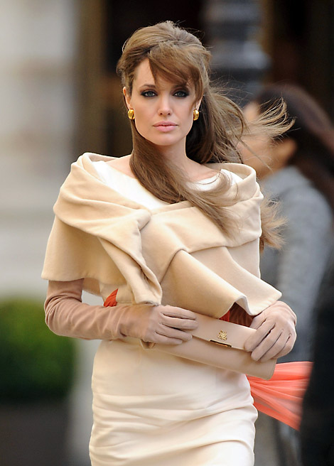 Celebrities in Gloves: Angelina Jolie in Opera Gloves. 'The Tourist' on set. Paris, 02/2010.