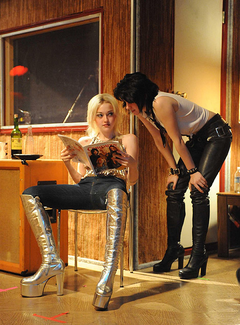 Celebrities in Boots: Kristen Stewart and Dakota Fanning. The Runaways Film Stills.