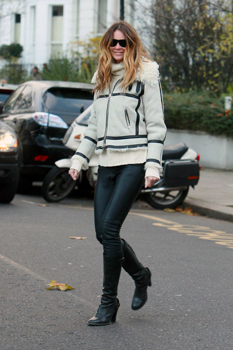 Celebrities in Boots/Leather: Elle MacPherson in Leather Pants and Knee Boots. London, 11.25.2010.