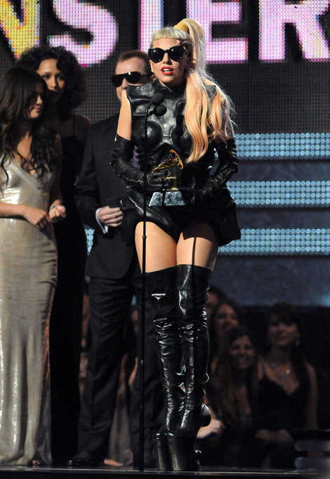 Celebrities in Boots/Gloves: Lady Gaga in Mugler by Nicola Formichetti Platform Thigh High Boots and Zipper Opera Gloves. Grammy Awards, 02.13.2011.