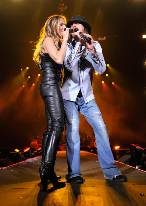 Celebrities in Boots/Leather: Sheryl Crow in Knee High Boots. Detroit, 01.15.2011.