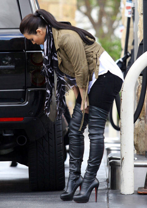Celebrities in Boots: kim Kardashian in Christian Louboutin Thigh High Boots. Los Angeles, 03.22.2011.