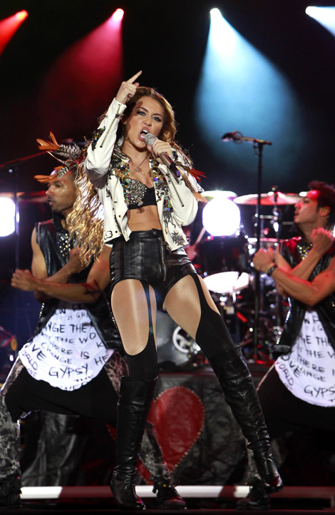 Celebrities in Boots: Miley Cyrus in Over The Knee Boots. Pasay City, 06.17.2011.