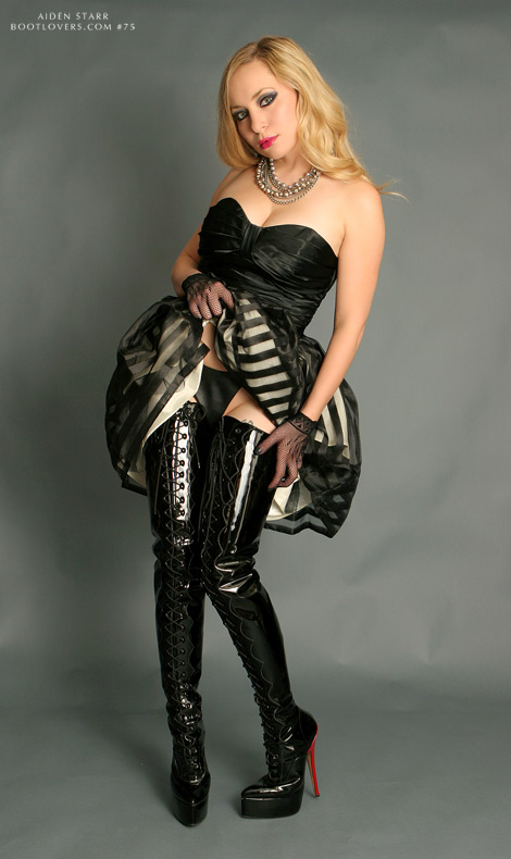 Bootlovers.com #75 Preview: Aiden Starr in Custom Little Shoe Box Black Patent Leather Thigh High Boots.