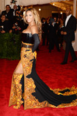 Celebrities in Boots/Gloves: Beyonce in Givenchy Over The Knee Boots and Opera Gloves. 2013 Met Gala at the Metropolitan Museum of Art, NYC. 05.06.2013.